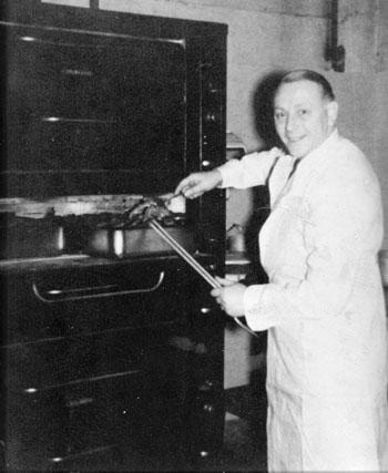 Joe Vanee roasting the beef.